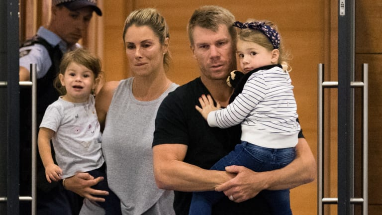David Warner arrives with his family in Sydney on Thursday night.