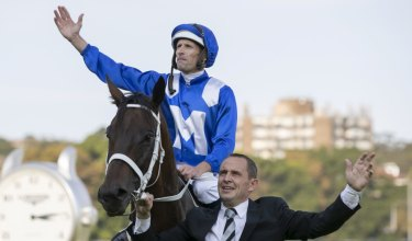 Final bow: Hugh Bowman and Chris Waller with Winx after the Queen Elizabeth Stakes.