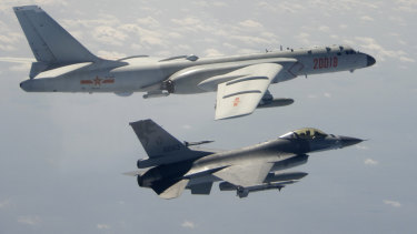 A Taiwanese Air Force F-16 in the foreground flies on the flank of a Chinese People's Liberation Army Air Force H-6 bomber in 2020.
