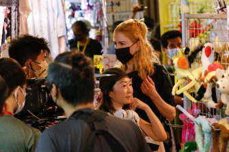 """Australian actor Nicole Kidman acts during the filming of a scene for the Amazon Prime series """"Expats"""" in Hong Kong on Monday. She was spotted at a COS shop last week."""