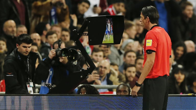 Coming to the big screen: referee Deniz Aytekin checks the VAR during a friendly between England and Italy.
