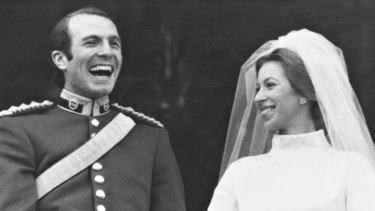 Princess Anne and Captain Mark Phillips on the Buckingham Palace balcony as they were cheered by a vast crowd after their wedding today.