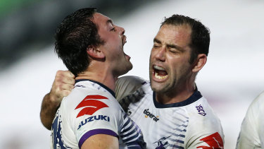 Brandon Smith celebrates a try with Cameron Smith in the Storm's win over the Knights.