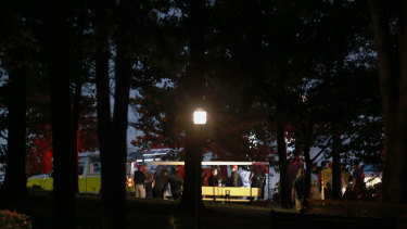 Emergency workers at the scene of a capsized tourist boat in Missouri.