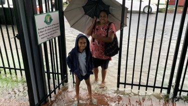 A student arrives at St Joseph's School in Cairns on Wednesday.