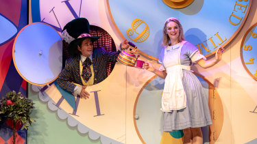 Dennis Manahan as the Mad Hatter and Ayesha Gibson as Alice in Alice in Wonderland.