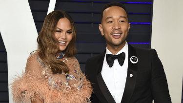 Chrissy Teigen and John Legend at the Vanity Fair Oscar Party.