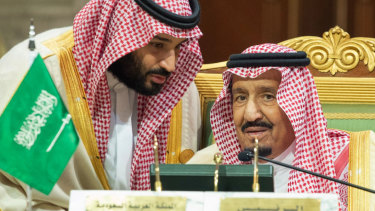 Saudi Crown Prince Mohammed bin Salman, left, speaks to his father, King Salman, right, at a meeting in Riyadh.