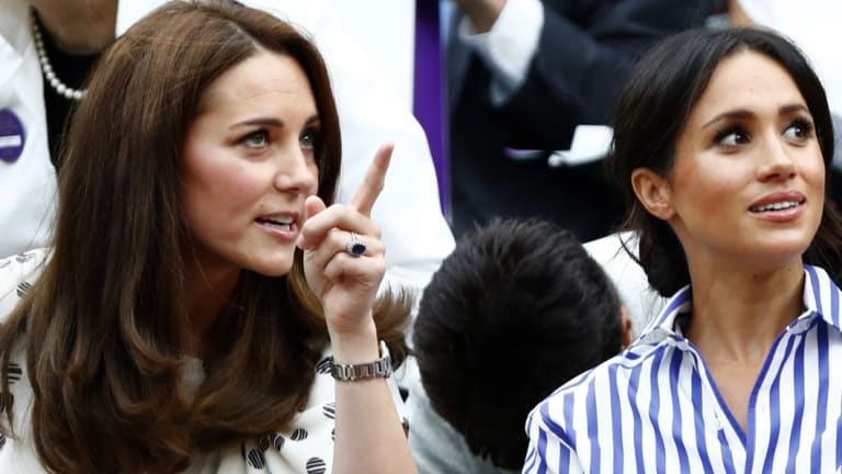 The Duchess of Cambridge and Meghan, Duchess of Sussex, watch the women's singles final at Wimbledon.