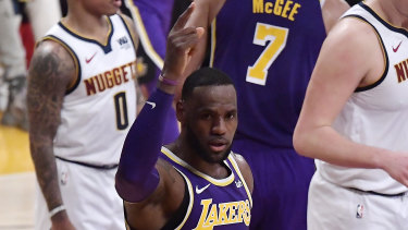 LA Lakers forward LeBron James gestures after scoring a basket that moved him past Michael Jordan on the NBA career scoring list.