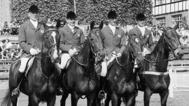 The Australian Olympic Equestrian team: (Left to Right) Laurie R. Morgan (Capt.) on 'Salad Days'; Neale Lavis on 'Mirrabooka'; William Roycroft on 'Our Solo'; and Bryan Crago on 'Sabre'.