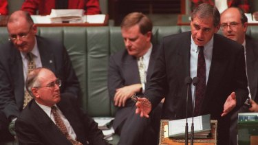 John Fahey with John Howard in Parliament. The then finance minister warned cabinet that Australia was slow to get ready for the millenium bug.