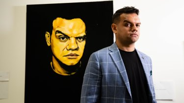 Meyne Wyatt with his self-portrait that won the Packer's Prize at this year's Archibald Prize.
