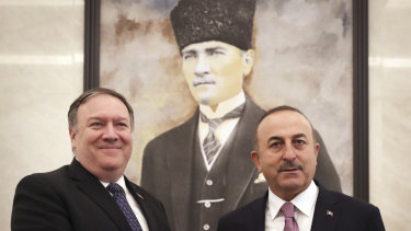 Turkey's Foreign Minister Mevlut Cavusoglu, right, and US Secretary of State Mike Pompeo meet in Ankara, Turkey.