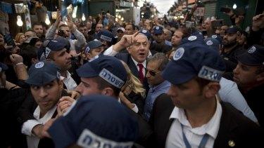 Israeli Prime Minister Benjamin Netanyahu visits a market in Tel Aviv.