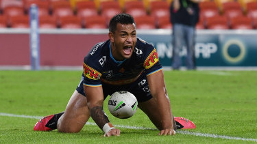 Phillip Sami of the Titans celebrates scoring the match-winning try against the Wests Tigers on Sunday.