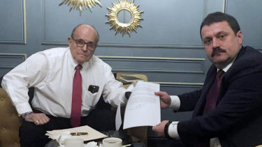 Rudy Giuliani, pictured with Ukrainian official Andriy Derkach, has been named as part of a Russia disinformation effort.