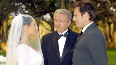 Sally Fletcher (Kate Ritchie) and Flynn ( Joel McIlroy) tie the knot as Donald Fisher (Norman Coburn) looks on in Home and Away.