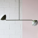 """The """"Jolly"""" double rod pendant combines hand-blown glass, solid metal rods and a choice of finishes."""