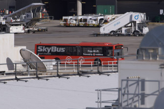 International arrivals in Melbourne are transported directly from their plane to a bus before being driven to their hotels.