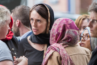 New Zealand Prime Minister Jacinda Ardern with members of Christchurch's Muslim community the day after the mosque attacks.