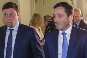 Opposition MP Tim Smith (left) and his leader, Matthew Guy, called for Daniel Andrews to resign on Wednesday.