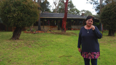 Eva Ricci, outside her old home in Wattleup. She moved from the home 11 years ago.