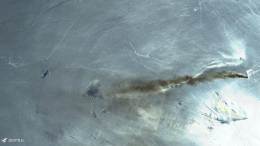 Satellite image shows the Norwegian-owned MT Front Altair ablaze with smoke rising from it in the Gulf of Oman.
