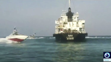 Panamanian-flagged oil tanker MT Riah  surrounded by Iranian Revolutionary Guard vessels, shown on Iranian-state TV.