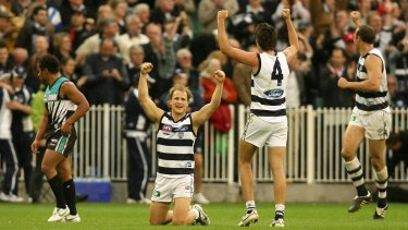 Geelong's Gary Ablett jnr, Andrew Mackie and Brad Ottens celebrate in 2007.