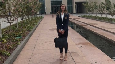 Brittany Higgins outside Parliament House on the first day of her job.