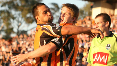 Familiar figure: Lawrence scores for the Tigers at CUA Stadium in Penrith back in 2007.