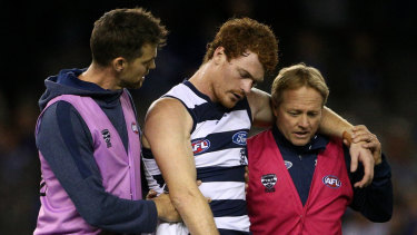 Gary Rohan leaves the field concussed.