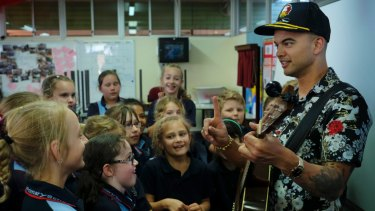 Guy Sebastian with children of Challice Primary in the ABC documentary Don't Stop The Music.
