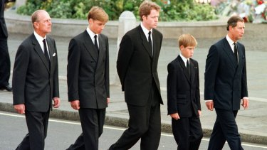 Prince Philip, Prince William, Earl Spencer, Prince Harry and Prince Charles walking behind Princess Diana's coffin.
