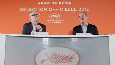 Festival director Thierry Fremaux, left, and festival president Pierre Lescure in front of the 2019 Cannes International Film Festival poster.
