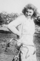 June Moore - as she was then - with her bicycle in 1943.