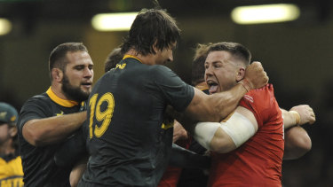 Feisty: Wales' Rob Evans (right) and South Africa's Eben Etzebeth tussle during the match.
