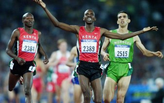Noah Ngeny of Kenya denies El Guerrouj in the 1500m final.
