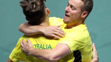 Hewitt embraces de Minaur during the recent Davis Cup teams event in Spain.