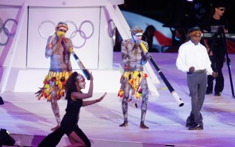 Yothu Yindi performs during the Sydney Olympics Closing Ceremony.
