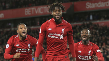 Liverpool forward Divock Origi celebrates after snatching a last-gasp win against Everton at Anfield.