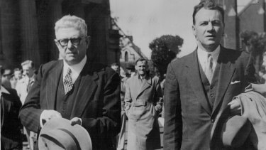 Dr Bert Evatt, left, leaves the court after his brief to appear at the Petrov Commission was withdrawn. September 08, 1954.