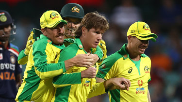 Aaron Finch congratulates Adam Zampa after the spinner dismissed Shikhar Dhawan.