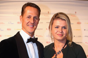 Michael Schumacher and wife Corinna in 2013. She has fiercely protected her husband's privacy since a skiing accident.
