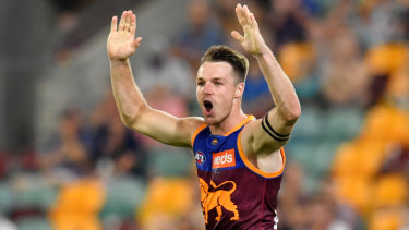 Ex-Cat gets the cream: Lincoln McCarthy celebrates a goal on debut for the Lions at the Gabba.