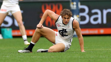 Stricken: Charlie Curnow of the Blues reacts after being injured at Optus Stadium.