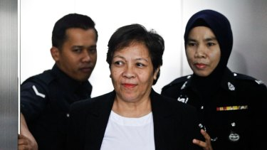 Australian Maria Elvira Pinto Exposto, centre, is escorted during a court hearing in Shah Alam, Malaysia last year.
