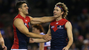 Fall-back forwards: Jayden Hunt of the Demons (right) celebrates a goal with teammate Christian Petracca.