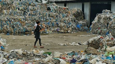 Piles of imported plastic wastes at a closed-down illegal plastic recycling factory in Jenjarom. Malaysia.